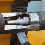 Deep hole boring machine for drilling and boring of the motor shaft inner profile